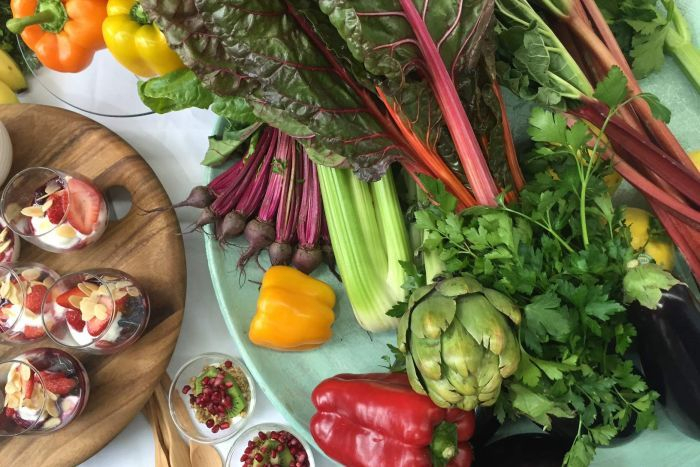 A table of healthy food, including fruit, vegetables and healthy snacks, recommended by the Cancer Council.